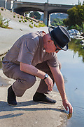 Lewis MacAdams, cofounder of Friends of the Los Angeles River (FoLAR) . Raphael Sbarge films FoLAR documentary along banks of Los Angeles River, Glendale Narrows, Los Angeles, California, USA