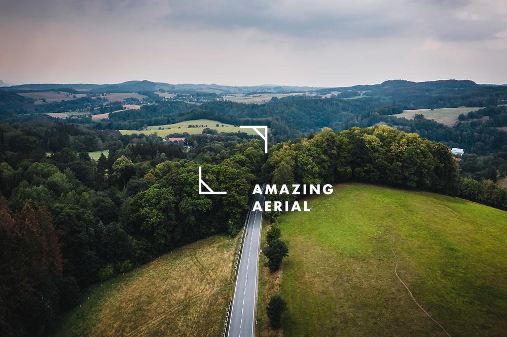 Aerial view of road trough forrest in National Park Sächsische Schweiz, Germany.
