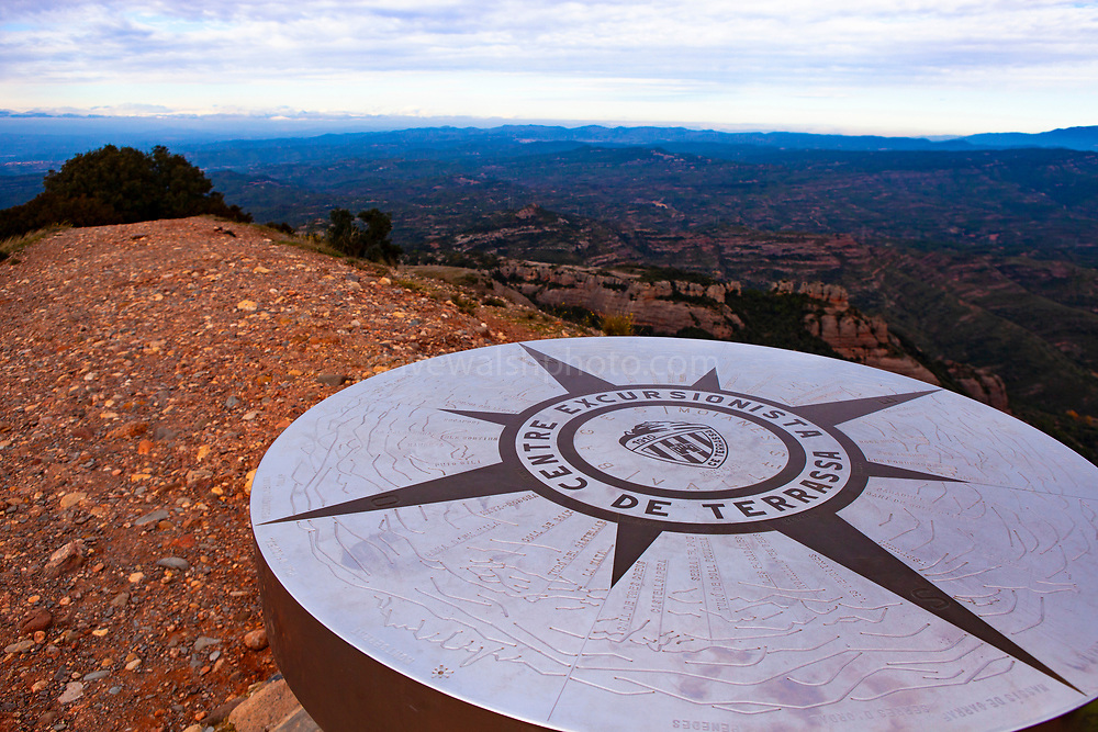 Compass rose on the 1056 metre high mountain of Montcau, in the Parc Natural Sant Llorenc del Munt massif, near Barcelona, Catalonia.