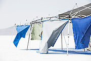 Image of tarp protection at Speed Week 2018 at the Bonnville Salt Flats, Utah, American Southwest by Randy Wells