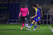 AFC Wimbledon midfielder Ethan Chislett (11) passing the ball during the EFL Sky Bet League 1 match between AFC Wimbledon and Peterborough United at Plough Lane, London, United Kingdom on 2 December 2020.