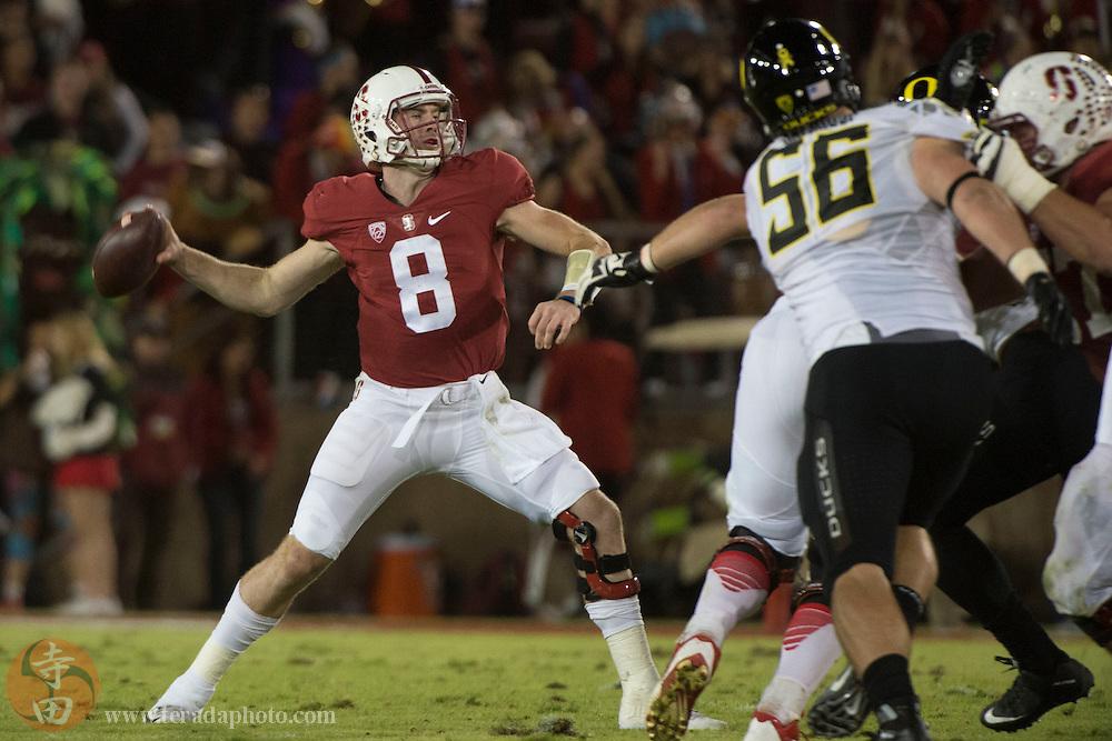 November 14, 2015; Stanford, CA, USA; Stanford Cardinal quarterback Kevin Hogan (8) passes the football against Oregon Ducks defensive lineman Alex Balducci (56) during the second quarter at Stanford Stadium.