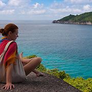 Girl sitting on the rock of Similan island #8