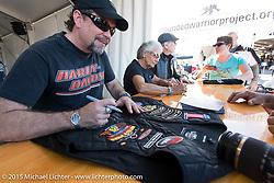 Bill, Nancy and Willie G. Davidson sign autographs in the Harley-Davidson display at the Daytona International Speedway during Daytona Bike Week 2015. FL, USA. Monday March 9, 2015.  Photography ©2015 Michael Lichter.