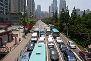 Traffic waits at traffic lights at the junction of Jia Jiao Bang Lu and Wanping Lu, Shanghai, China. In addition to the buses, taxis and transport vehicles on Shanghais busy streets, personal car use is increasing. The result is a city with very polluted air, and streets full of cars.