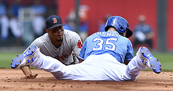 June 21, 2017 - Kansas City, MO, USA - Kansas City Royals' Eric Hosmer reaches second before the tag form Boston Red Sox shortstop Xander Bogaerts on a double in the second inning during Wednesday's baseball game at Kauffman Stadium in Kansas City, Mo. (Credit Image: © John Sleezer/TNS via ZUMA Wire)