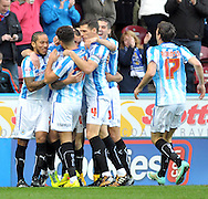 Joel Lynch of Huddersfield Town is congratulated after his goal against Nottingham Forest during the Sky Bet Championship match at the John Smiths Stadium, Huddersfield<br /> Picture by Graham Crowther/Focus Images Ltd +44 7763 140036<br /> 01/11/2014