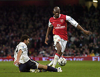 Photo: Olly Greenwood.<br />Arsenal v Tottenham Hotspur. Carling Cup Semi Final 2nd leg 31/01/2007. Spurs Hossam Ghaley tacklesd Arsenal Abou Diaby