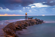 Bal Harbour Lighthouse Jetty on the northern tip of Miami Beach protects the inlet beaches from stormy waters and its light is a warning to boats heading near the jetty.