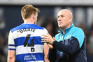 QPR manager Mark Warburton  and QPR defender Rob Dickie (4) during the EFL Sky Bet Championship match between West Bromwich Albion and Queens Park Rangers at The Hawthorns, West Bromwich, England on 24 September 2021.
