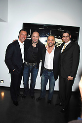 Left to right, FRANK FERTITTA, DANA WHITE the current President of the Ultimate Fighting Championship, LORENZO FERTITTA and DANA WHITE the current President of the Ultimate Fighting Championship and at a private view of Octagan a showcase of work of photographer Kevin Lynch featuring the stars of the Ultimate Fighter Championship held at Hamiltons gallery, Mayfair, London on 17th January 2008.<br /><br />NON EXCLUSIVE - WORLD RIGHTS