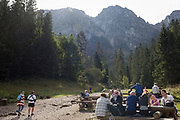 Polish hikers rest on seats and benches on the footpath leading towards the climb up to Sarnia Skala, a mountain in the Tatra National Park, on 16th September 2019, near Koscielisko, Zakopane, Malopolska, Poland.