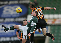 Photo: Lee Earle.<br /> Plymouth Argyle v Hull City. Coca Cola Championship. 09/12/2006. Hull's David Livermore (R) clashes with Paul Wotton.