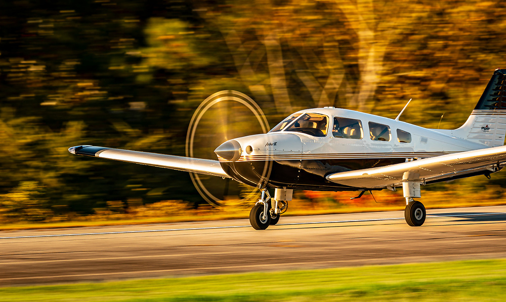 Flight instructor Michelle Curcio, of Horizon Dreams Aviation, lands her Piper Archer III at Habersham County Airport in Cornelia, Georgia.<br /> <br /> Created by aviation photographer John Slemp of Aerographs Aviation Photography. Clients include Goodyear Aviation Tires, Phillips 66 Aviation Fuels, Smithsonian Air & Space magazine, and The Lindbergh Foundation.  Specialising in high end commercial aviation photography and the supply of aviation stock photography for advertising, corporate, and editorial use.