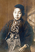 young boy portrait in formal kimono dress Japan 1915