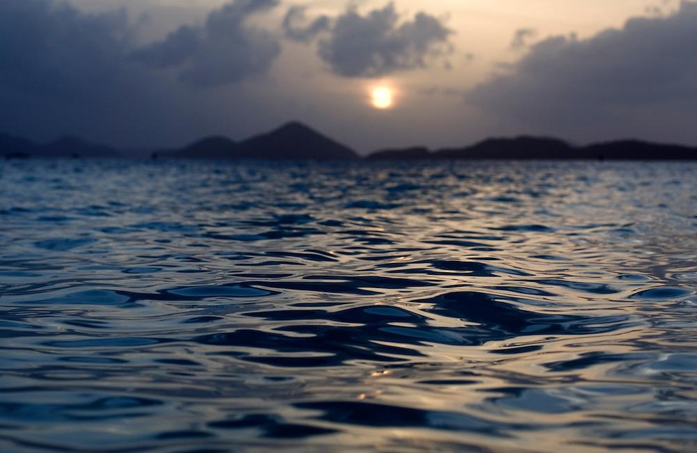 Sunset over a wave in Solomon's Bay St. John, U.S. Virgin Islands.