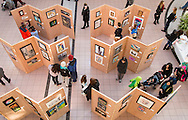 """Town of Wallkill, New York - People look at art on exhibit at the Orange County Arts Council All-County High School Arts Display at the Galleria at Crystal Run on Feb. 28, 2015. The theme of the event was: """"Arts Build Confidence""""."""