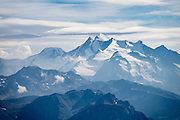 """The Dom (4545 m / 14,911 ft) is the third highest mountain in the Alps and the second highest in Switzerland (after Monte Rosa). Located in the Pennine/Valais Alps between Randa (in Matter Valley) and Saas-Fee, the Dom is the main summit of the Mischabel Group (German: Mischabelhörner), the highest massif lying entirely in Switzerland. The Mischabel Group (ancient German term for pitchfork) includes many summits above 4000 meters: the Nadelgrat (to north/photo right), composed of the Lenzspitze, the Nadelhorn (4327 m/14,196ft """"Needle Peak""""), Stecknadelhorn, Hohberghorn and Dürrenhorn; and Täschhorn (4491 m south/just left of highest peak in photo), plus the flat summit of the Alphubel (4206m / 13,799ft, further left)."""