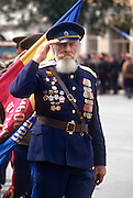 An elderly Russian Don Cossack salutes during a blessing at the Ascension Cathedral in Novocherkassk, Russia. The men are participating in the annual Cossack Festival gathering of units from around Russia.