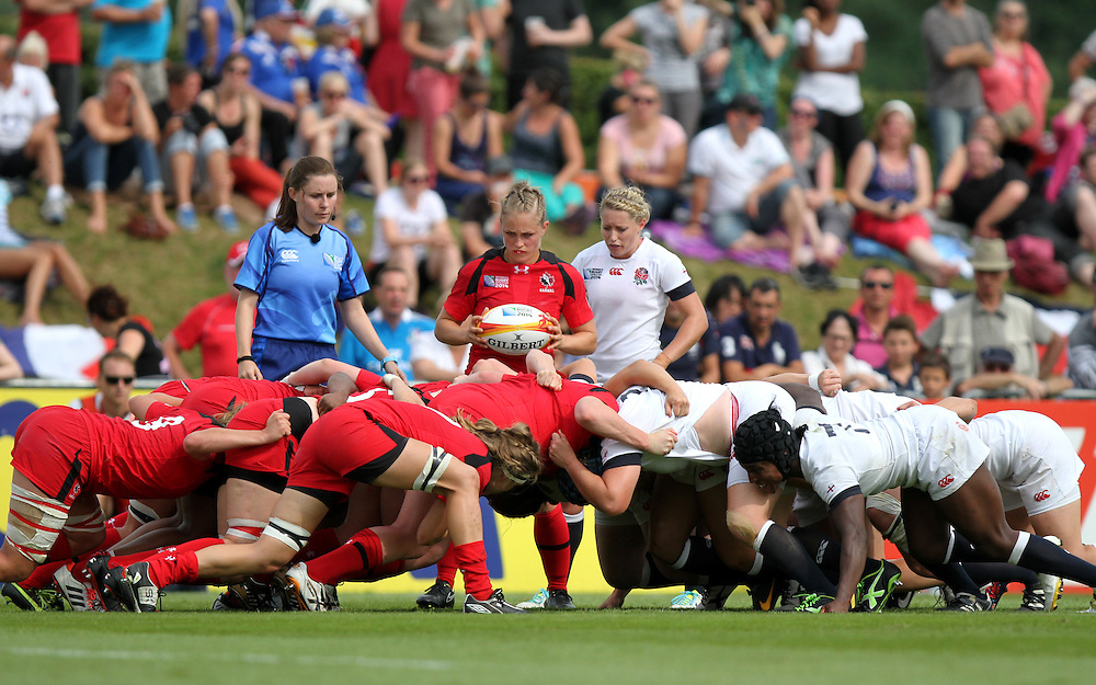 Stephanie Bernier and Natasha Hunt at a scrum. England v Canada Pool A match at WRWC 2014 at Centre National de Rugby, Marcoussis, France, on 9th August 2014