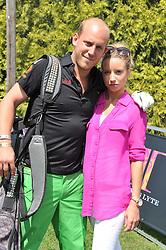 CARLO CARELLO and SOPHIA WINNINGTON at the Leuka Mini Masters Golf at Dukes Meadows, Chiswick, London on 15th July 2011.