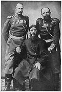 Grigoriy Efimovich Rasputin (?1871-1916) centre. Russian mystic and 'holy man' who exercised influence over Nicholas II and the Tsarina, seated between Colonel Loma (left) and Prince Putianin