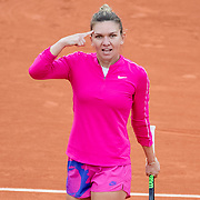 PARIS, FRANCE September 30. Simona Halep of Romania reacts towards her coach after a poor decision during her match against Irina-Camelia Begu of Romania in the second round of the singles competition on CourtSuzanne Lenglen during the  French Open Tennis Tournament at Roland Garros on September 30th 2020 in Paris, France. (Photo by Tim Clayton/Corbis via Getty Images)