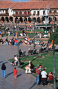 PERU, HIGHLANDS, CUZCO Plaza de Armas with arcaded buildings