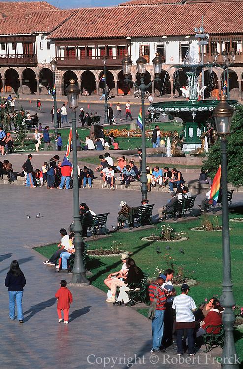 PERU, HIGHLANDS, CUZCO Plaza de Armas with arcaded buildings