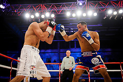 James DeGale (blue shorts) fights Gevorg Khatchikian (white shorts) going on to defend his WBC Silver super middleweight title with an 11th round stoppage<br />  - Photo mandatory by-line: Rogan Thomson/JMP - Tel: 07966 386802 - 01/03/2014 - SPORT - BOXING - The City Academy, Bristol - James DeGale v Gevorg Khatchikian.