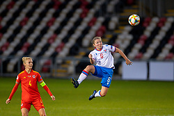 NEWPORT, WALES - Thursday, October 22, 2020: Faroe Islands' Heidi Sevdal heads the ball as Wales' captain Sophie Ingle looks on during the UEFA Women's Euro 2022 England Qualifying Round Group C match between Wales Women and Faroe Islands Women at Rodney Parade. Wales won 4-0. (Pic by David Rawcliffe/Propaganda)
