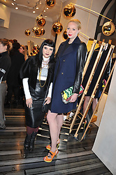 Left to right, PRINCESS JULIA and GWENDOLINE CHRISTIE at a party to celebrate the launch of a limited edition shoe The Chambord in celebration of Nicholas Kirkwood's partnership with Chambord black raspberry liqueur, held at the Nicholas Kirkwood Boutique, 5 Mount Street, London on 12th December 2012.