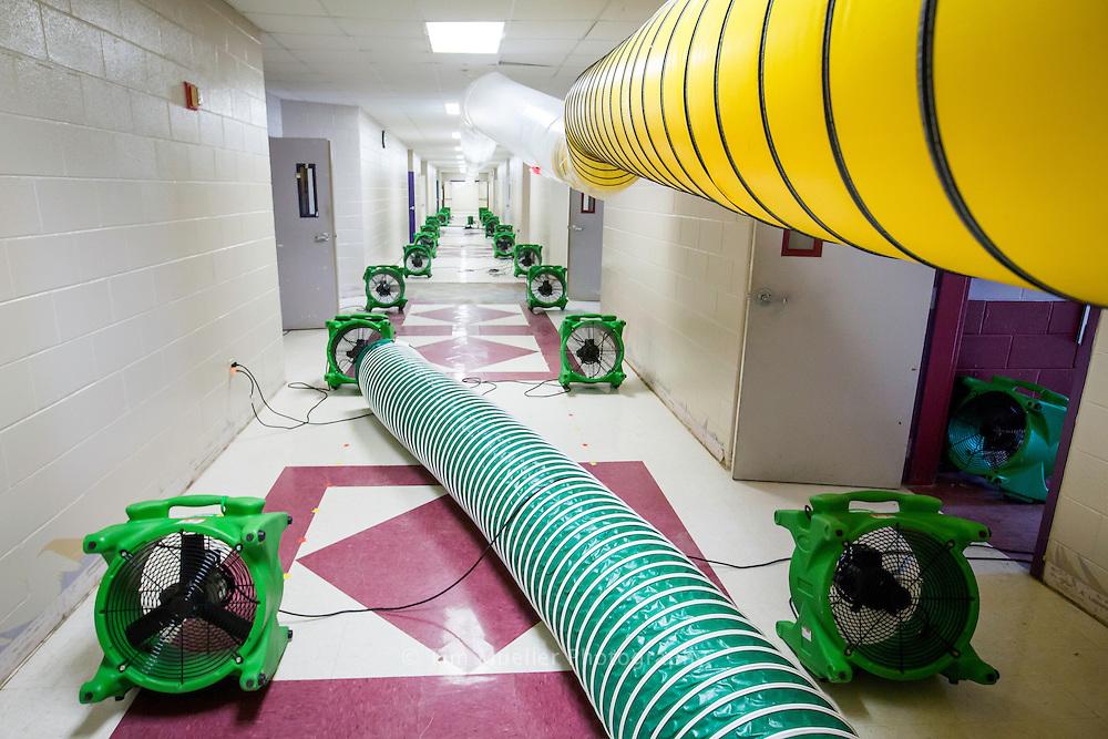 Clean-up crews are working around the clock to restore flood damaged Denham Springs Junior High School. Livingston Parish School System officials plan to reopen Livingston Parish schools Monday, September 12.