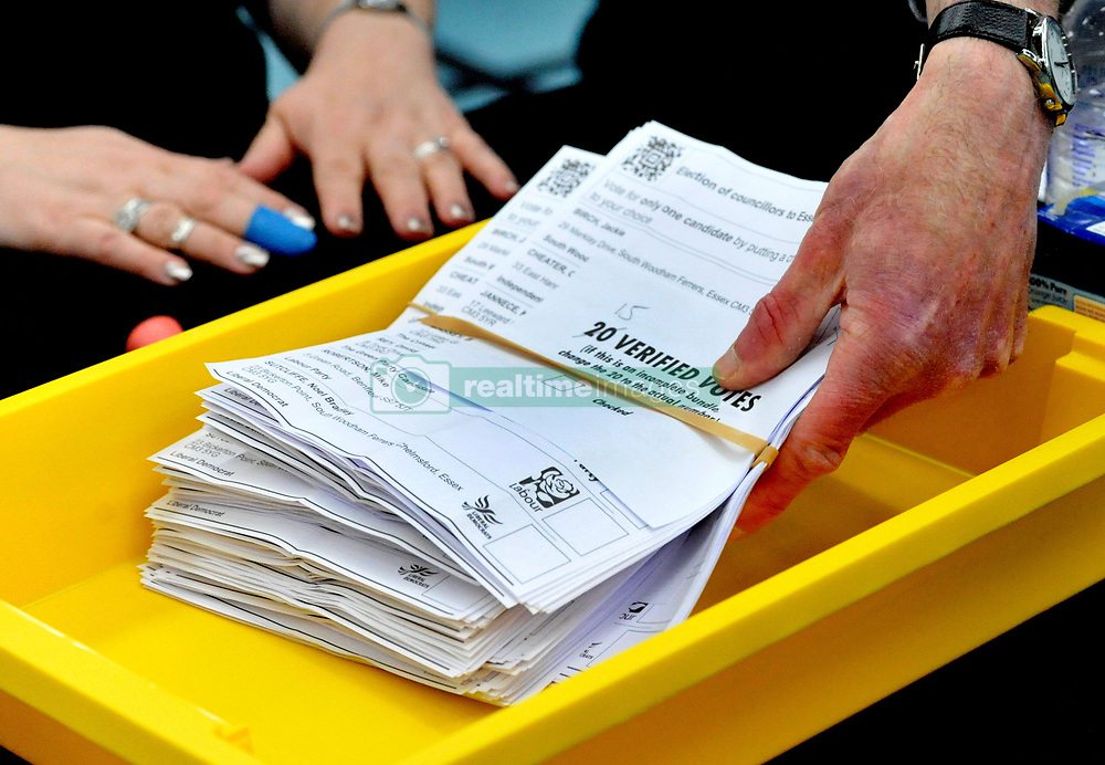 Verified ballot papers are collected from a tray at the local election count at Riverside Ice & Leisure Centre in Chelmsford, Essex.