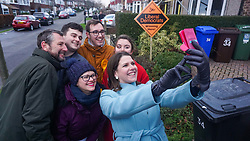 © Licensed to London News Pictures. 9/12/2019. Sheffield , UK. Jo Swinson leader of the Liberal Democrat poses for a selfie with Liberal Democrat candidates for Sheffield Central Colin Ross (L) and Penitsone and Stocksbridge Hannah Kitching (2L) and volunteers while out canvassing for the general election in Sheffield, in Sheffield. Britain will go to the polls on December 12, 2019 to vote in a pre-Christmas general election.  Photo credit: Ioannis Alexopoulos /LNP