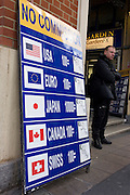 Foreign currency exchange board advertising No Commission in central London.
