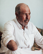 Fouad Abu Sake picked up an object in the desert twenty years ago near Sidi Abd El Rahmen. When it exploded he lost his right arm above the elbow and was hit in the face by shrapnel. Fouad's older brother, Meftah, was killed by a mine while walking in the desert in the early 1950s.