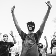 """Protesters at a Black Lives Matter demonstration in Simi Valley, a conservative, predominantly white suburb of Los Angeles, yell """"hands up, don't shoot"""" on Juneteenth."""