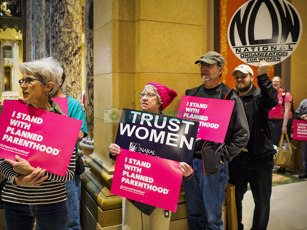 May 4, 2017 - St. Paul, Minnesota, United States - Women and men line the hallways of the Minnesota Capitol and chant pro-choice slogans. About 50 people came to a protest to urge Minnesota State Senators to vote against two bills supported by the Republican party that would restrict access to women's health care in Minnesota. The protest was organized by  NARAL Pro-Choice Minnesota, NCJW Minnesota, and Planned Parenthood Minnesota. The Senate passed the bills but Minnesota's Democratic governor is expected to veto the legislation when it reaches his desk. (Credit Image: © Jack Kurtz via ZUMA Wire)