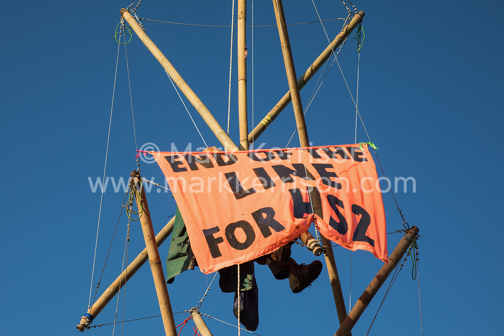 An anti-HS2 activist uses a tripod to block one of several entrances blocked to the Chiltern Tunnel South Portal site for the HS2 high-speed rail link on 9 October 2020 in West Hyde, United Kingdom. The protest action, at the site from which HS2 Ltd intends to drill a 10-mile tunnel through the Chilterns, was intended to remind Prime Minister Boris Johnson that he committed to remove deforestation from supply chains and to provide legal protection for 30% of UK land for biodiversity by 2030 at the first UN Summit on Biodiversity on 30th September.
