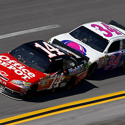 April 17, 2011; Talladega, AL, USA; NASCAR Sprint Cup Series driver David Gilliland (34) drafts Tony Stewart (14) during the Aarons 499 at Talladega Superspeedway.   Mandatory Credit: Derick E. Hingle