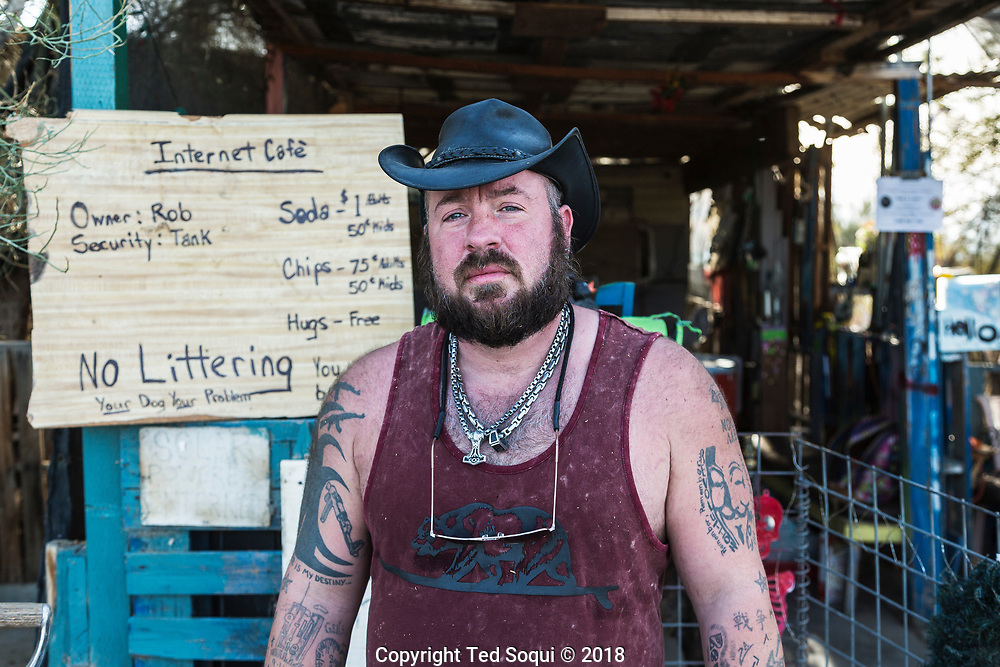 """""""Tank,"""" security at the Internet Cafè.<br /> Slab City and the local environs."""