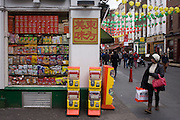 Gerrard Street retailer and local shopper in London's Chinatown.