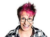 Close-up portrait of a happy young  with a shocked funny face woman in studio on white isolated background