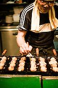 "Making Takoyaki, squid balls, in Ame-mura--short for ""American Town""."
