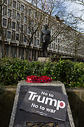 Detail of a war memorial and the statue of Ronald reagan outside the London US Embassy at the Stop Trump's Muslim ban demonstration on 4th February 2017 in London, United Kingdom. The protest was called on by Stop the War Coalition, Stand Up to Racism, Muslim Association of Britain, Muslim Engagement and Development, the Muslim Council of Britain, CND and Friends of Al-Aqsa. Thousands of demonstrators gathered to demonstrate against Trumps ban on Muslims, saying it must be opposed by all who are against racism and support basic human rights, and for Theresa May not to collude with him.