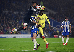 Brighton and Hove Albion goalkeeper Robert Sanchez collides with team-mate Lewis Dunk attempting to clear the ball from Arsenal's Gabriel Magalhaes during the Premier League match at the AMEX Stadium, Brighton. Picture date: Saturday October 2, 2021.