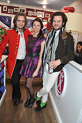 Left to right, Victor Bournaud, Julie  Clermbourg and James Harvey-Kelly at the launch party for the Vicomte A boutique in London at 113 King's Road, London SW3 on 13th December 2012.