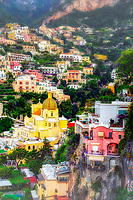 """""""Early morning sun on the cliffs of Positano""""…<br /> <br /> There was only one occasion that I was really able to pre-plan taking photos at sunrise and that was during the last day of three in Positano.  It takes much planning, logistics, and familiarity to figure the best locations and the proper angles and positions of the sun.  My third morning was ideal and fortuitous as it began raining about 10:00 am, which gave me perfect clouds for sunrise, finally ending with a very cold wind just in time for sunset.  This image is one of the rare photos of a slumbering Positano in the dewing morning around 6:30 am at the end of May….the beginning of peak tourist season.  By 8:00 am, this tiny seaside village is bustling with tourists and shop owners, and restaurateurs trying to satisfy every need.  All in all, Positano was by far the plushest of all locations I visited in Italy, and I was blessed to witness everything in full bloom."""
