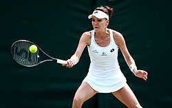 Agnieszka Radwanska in action against Christina McHale on day four of the Wimbledon Championships at The All England Lawn Tennis and Croquet Club, Wimbledon.